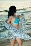 Woman on beach holding scarf royalty free stock photography
