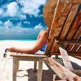 Woman at beach holding sunglasses Stock Photos