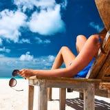 Woman at beach holding sunglasses Royalty Free Stock Photos