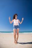 Woman in beach horns hands Stock Photos