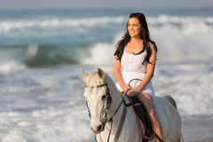 Woman beach horse ride. Carefree young woman morning beach horse ride Royalty Free Stock Images