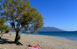 A woman on the beach on the island of samos greece royalty free stock images