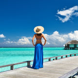 Woman on a beach jetty at Maldives Royalty Free Stock Photography