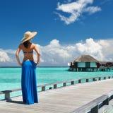 Woman on a beach jetty at Maldives. Woman on a tropical beach jetty at Maldives Royalty Free Stock Image
