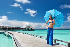 Woman on a beach jetty at Maldives Royalty Free Stock Photo