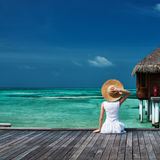 Woman on a beach jetty at Maldives Stock Photography