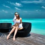 Woman on a beach jetty at Maldives Royalty Free Stock Photo