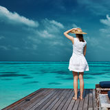 Woman on a beach jetty at Maldives Stock Photography