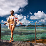 Woman on a beach jetty at Seychelles, La Digue. Royalty Free Stock Photo