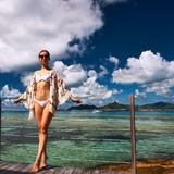 Woman on a beach jetty at Seychelles, La Digue. Royalty Free Stock Image