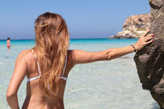 Woman at beach of Lampedusa Stock Images