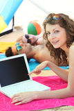 Woman on a beach with laptop stock images