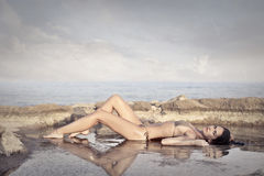 Woman on the beach. Laying woman on the beach Royalty Free Stock Photos