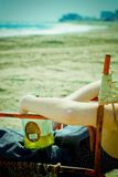 Woman on beach with liquor Royalty Free Stock Photography