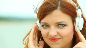Woman on Beach Listening to Music stock video footage