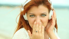 Woman on Beach Listening to Music stock footage
