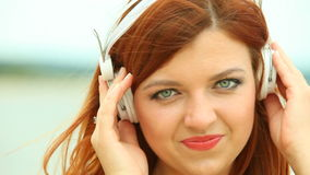 Woman on Beach Listening to Music Stock Photography