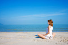 Woman by the beach look side way. Woman relaxing look side way by the beach Stock Images