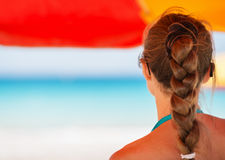 Woman on beach looking into distance Royalty Free Stock Photos