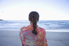 Woman on beach, looking out to sea, rear view Stock Photography