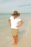 Woman on the Beach Looking for Sea Shells Royalty Free Stock Photography