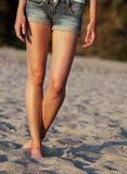 Woman on the beach - lower body Royalty Free Stock Photography