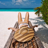 Woman at beach lying on chaise lounge. Woman at beautiful beach lying on chaise lounge royalty free stock image