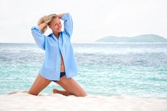 Woman on the beach in men's shirt Royalty Free Stock Photo