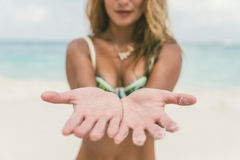 Woman on the beach with open hands showing palms Stock Photo