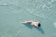 Woman on beach from overhead Royalty Free Stock Images