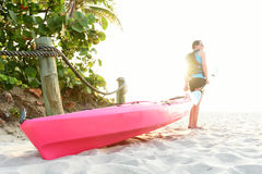 Woman on beach with pink kayak Royalty Free Stock Image