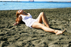 Woman on beach stock images