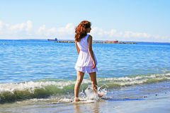 Woman on beach stock photo