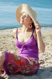 Woman at the beach relaxing Royalty Free Stock Photo