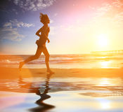 Woman beach running Royalty Free Stock Image