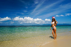 Woman on the Beach with Santa Claus Hat. Celebrating Christmas and New Year in Hot Country Stock Image
