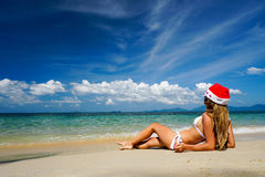 Woman on the Beach with Santa Claus Hat. Celebrating Christmas and New Year in Hot Country Stock Images