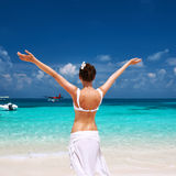 Woman at beach. Seaplane at background. Stock Photography