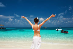Woman at beach. Seaplane at background. Royalty Free Stock Photos
