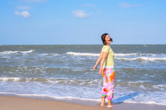 Woman on the beach shouts of delight Stock Photography