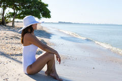 Woman at the beach. Woman sitting at the beach stock images