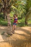 Woman on the beach sitting palm tree Stock Photos