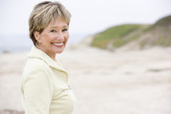 Woman at the beach smiling Stock Photos