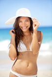Woman on beach smiling happy Stock Photo