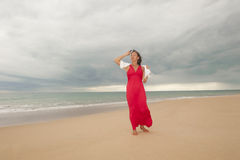 Woman at beach and storm clouds over ocean Stock Photography