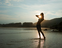 Woman on beach. Stretching, enjoying the beach Stock Photo