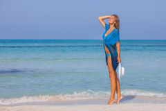 Woman on beach summer holiday slim and beautiful Royalty Free Stock Image