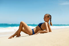 Woman On Beach In Summer. Sexy Happy Female Model Tanning Royalty Free Stock Photo