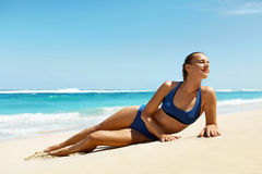 Woman On Beach In Summer. Sexy Happy Female Model Tanning Stock Photo