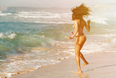 Woman on beach in summer vacation stock image